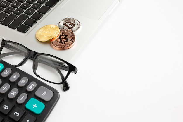 Bitcoin sitting on laptop with copy-space Free Photo