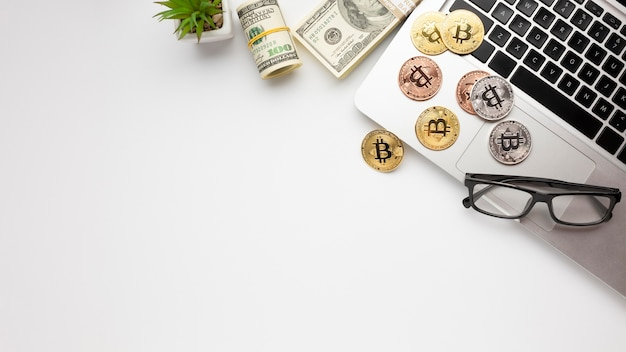 Bitcoin on top of laptop flat lay Free Photo