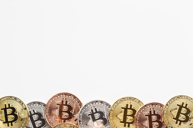 Bitcoin in various colors frame Premium Photo