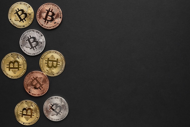 Bitcoin in various colors with copy-space Free Photo