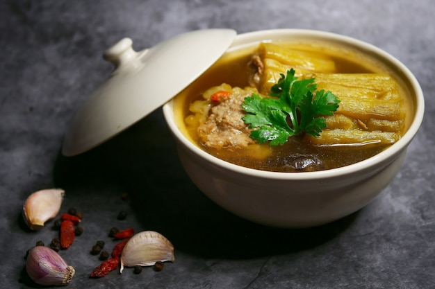 Bitter gourd soup with minced pork and shiitake mushroom Premium Photo
