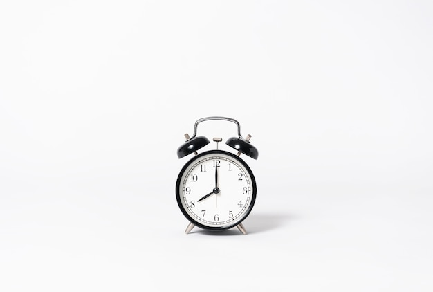 Black alarm clock on gray background. minimal object creative idea. Premium Photo