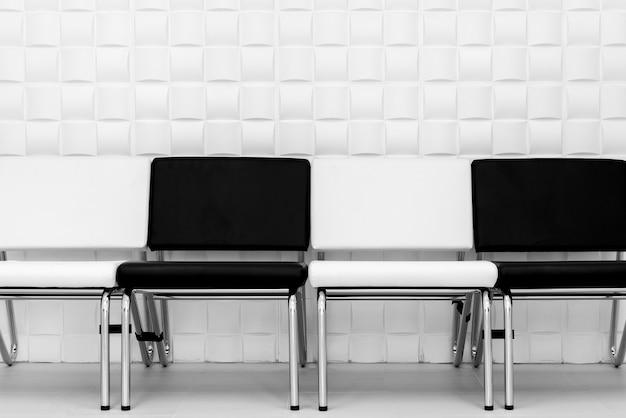 black n white furniture. Black And White Chairs On Pattern Wall Premium Photo Black N Furniture