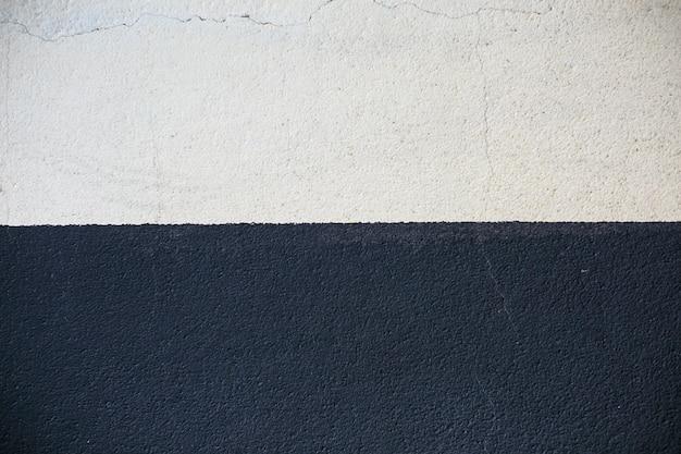 흑인과 백인 질감 시멘트 벽 배경 프리미엄 사진