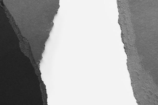 黒と白の破れた紙 Premium写真