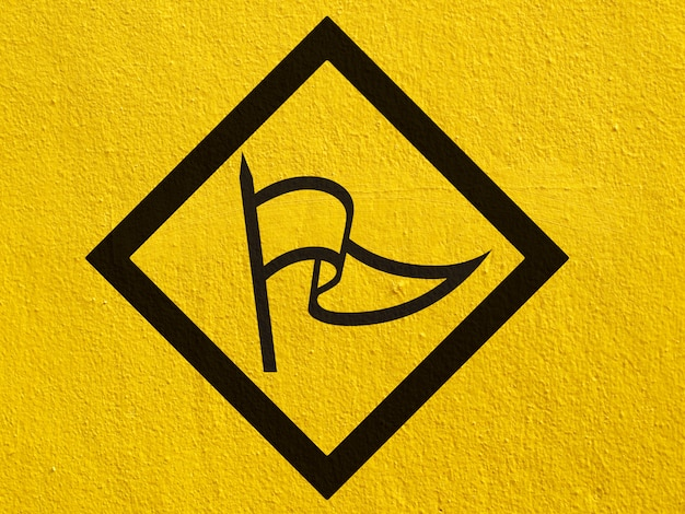 A black arrow points painted on a stucco wall outside Premium Photo