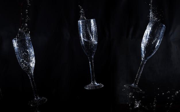 Sfondo nero con tre bicchieri d'acqua Foto Gratuite