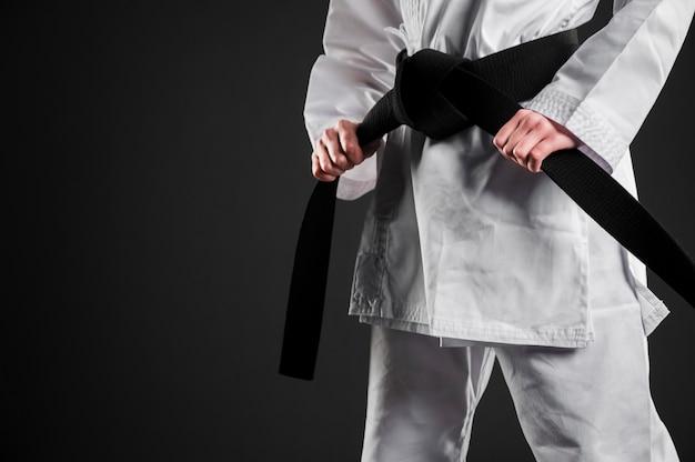 Black belt karate fighter copy space Premium Photo
