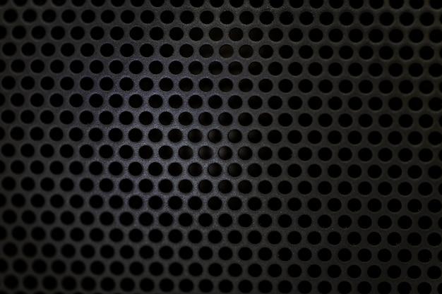 Black bluetooth speaker texture Premium Photo