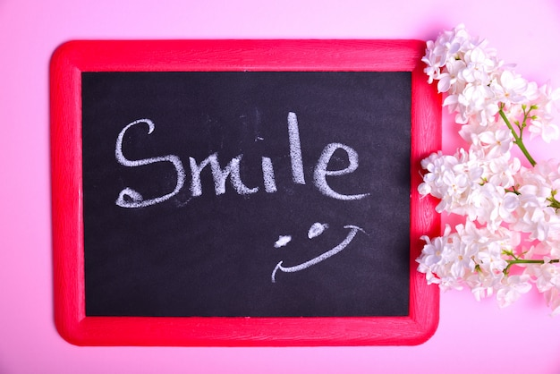 Black board with an inscription smile Premium Photo