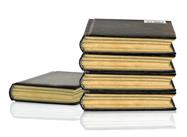 Black book is laying with shadow on white background Premium Photo