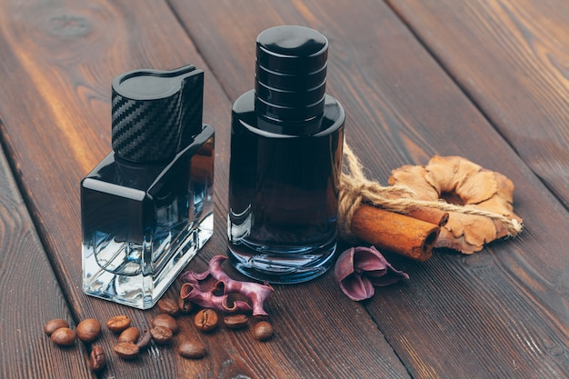 Black bottle of perfume placed on a wooden table Premium Photo