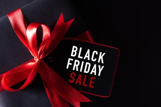 Black box with red ribbon Premium Photo