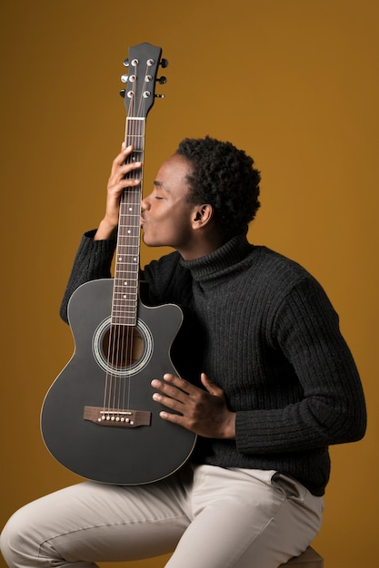 Black boy playing the guitar Free Photo