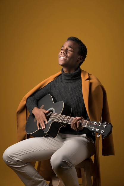 Black boy playing the guitar Free Photo