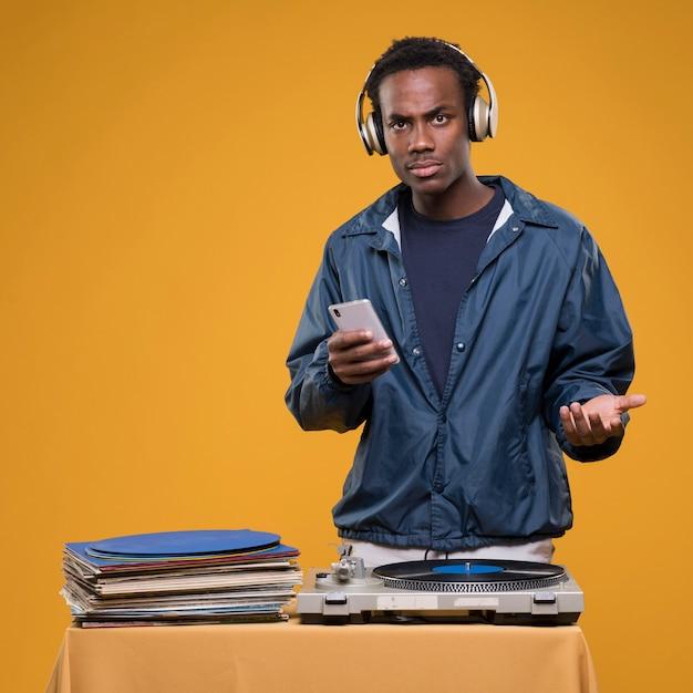 Black boy posing with headphones Free Photo