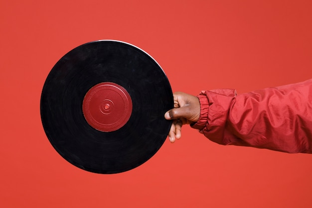 Black boy posing with vinyls Free Photo