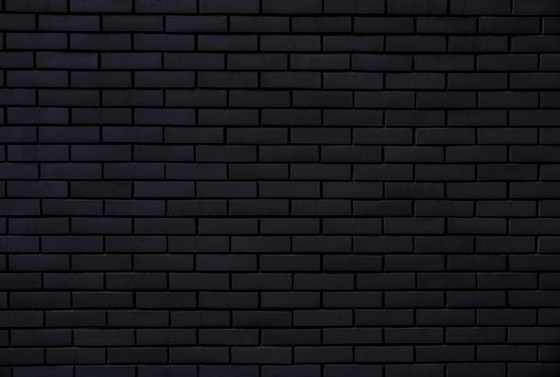 Black brick wall for background and texture Premium Photo