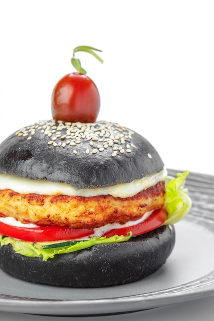 Black burger isolated on white Premium Photo