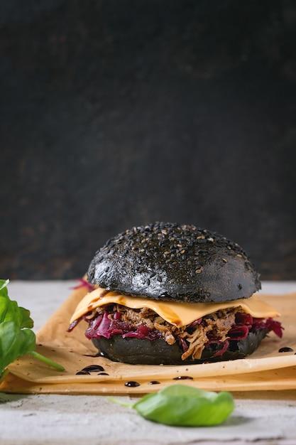 Black burger with stews Premium Photo