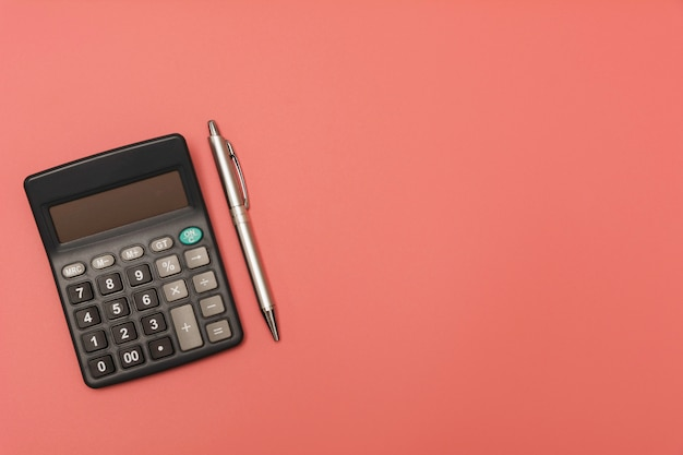 Black calculator with pen and copy space. Premium Photo