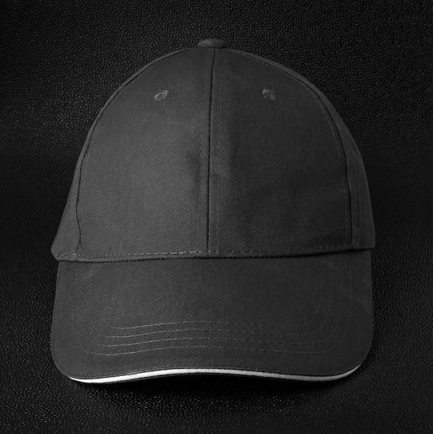 Black cap dark background. template of baseball cap in front view. Premium Photo