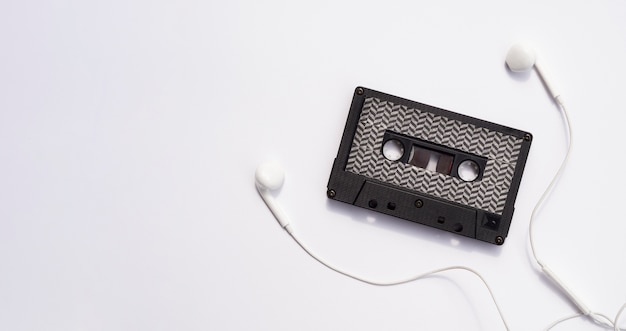 Black cassette tape with earphones and copy-space Free Photo