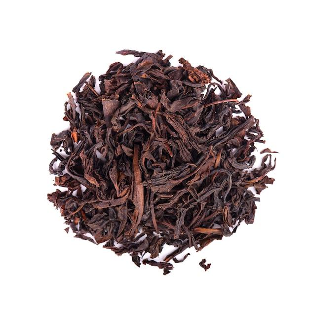 Черный цейлонский чай с анона, изолированных на белом фоне. вид сверху. Premium Фотографии