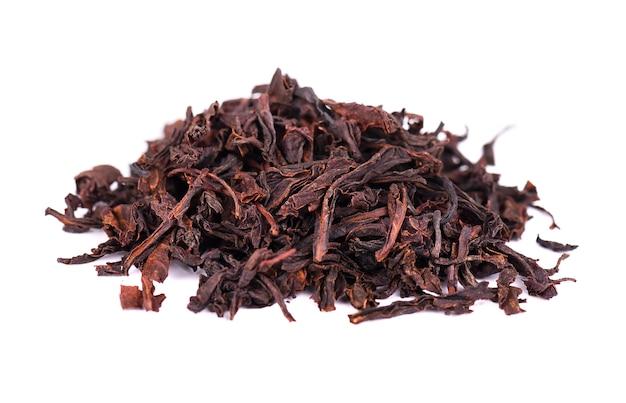 Черный цейлонский чай с анона, изолированных на белом фоне. Premium Фотографии