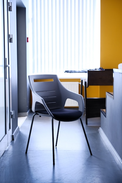 Black chair in corridor of apartment Premium Photo
