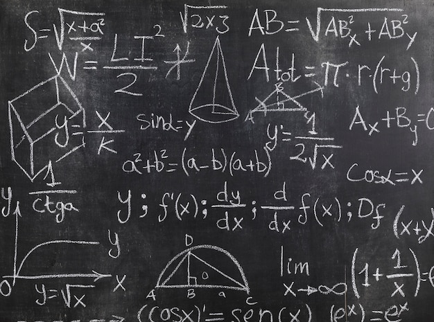 Black chalkboard with mathematical formulas and problems Free Photo