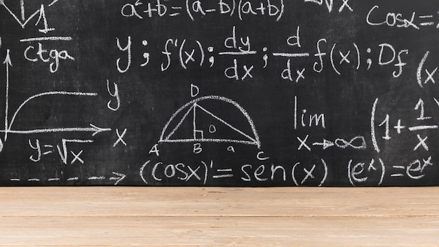 Black chalkboard with mathematical problems Free Photo