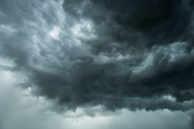 Black cloud and thunderstorm before rainy, dramatic  black clouds and dark sky Premium Photo