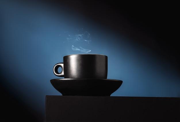 Black coffee cup on blue Premium Photo