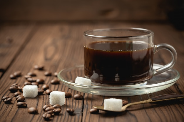 Black coffee cup on wooden table. Free Photo