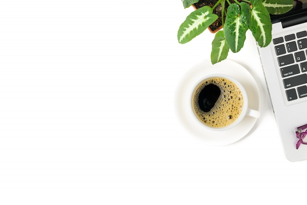 Black coffee and laptop with small plant pot isolated on white background, top view and copy space Premium Photo
