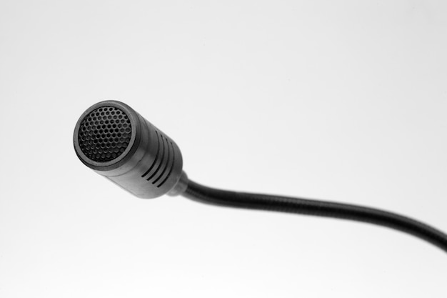 Black computer microphone on a white background. Premium Photo