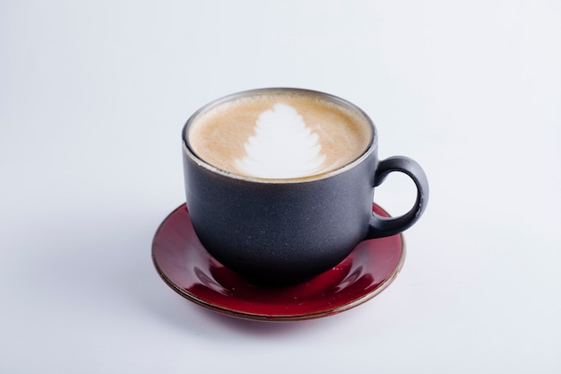 A black cup of cappuccino. Free Photo