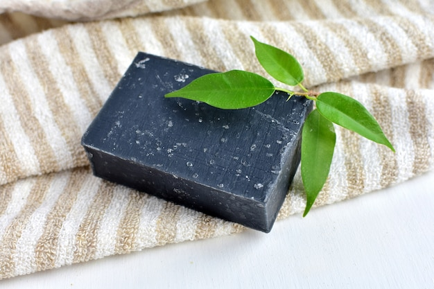 Black detox soap with activated charcoal, organic, handmade, zero waste product. Premium Photo