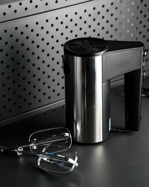 Black electric mixer on the table Free Photo