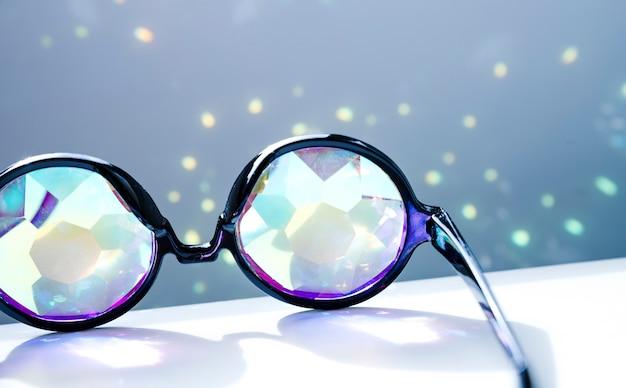 Black eyeglasses with shiny sparkling lights Free Photo