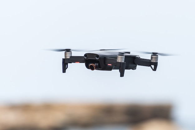 Black flying drone in the sky Premium Photo