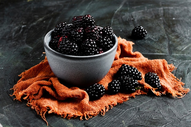 Black forest fruits in bowl Free Photo