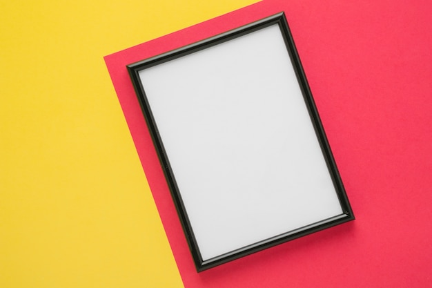 Black frame on bicolor background Free Photo