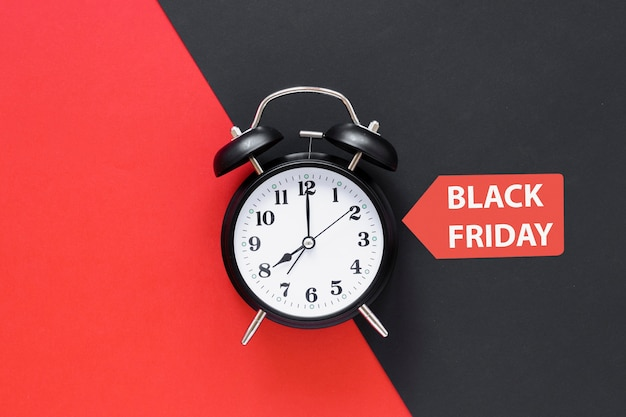 Black friday alarm clock with sticker Free Photo