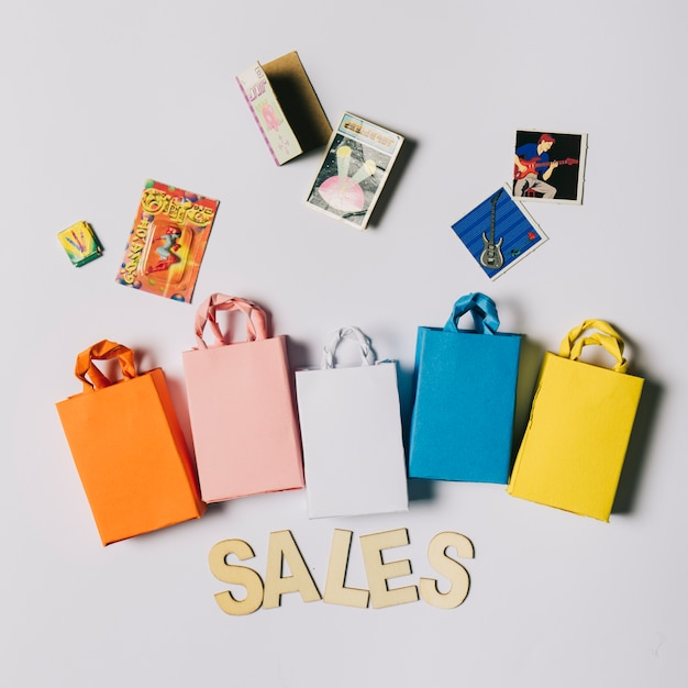 Black friday concept with bags and cd covers Photo | Free