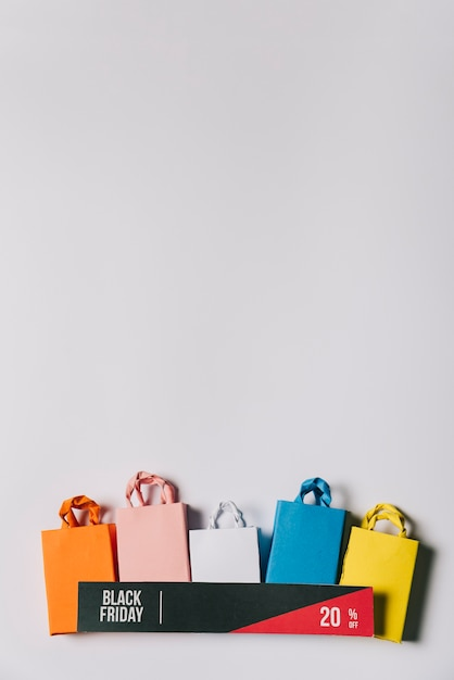 Black friday concept with banner and bags Free Photo