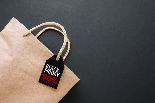Black friday discount bag in flat lay Free Photo