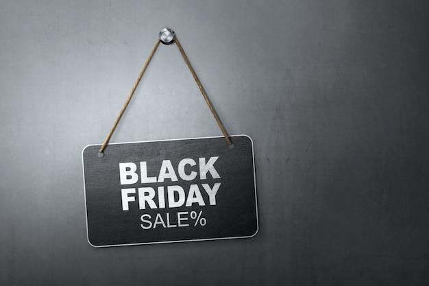 Black friday discount sale message written on hanging blackboard Premium Photo