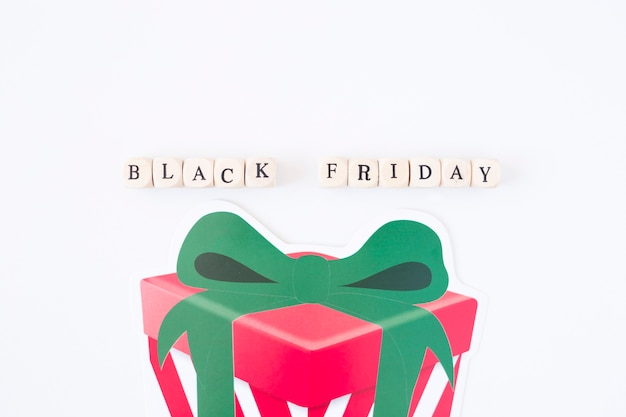 Black friday inscription on cubes with paper gift box Free Photo